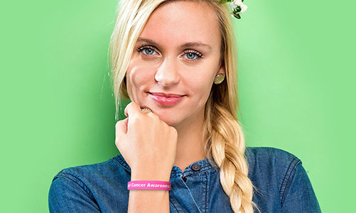 Girl wearing a silicone wristband